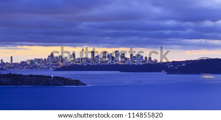 Sydney australia panoramic view at sunset from North Head over harbour towards city CBD and bridge