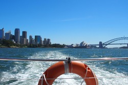 Sydney, Australia - Sydney skyline view from a boat with the Sydney Opera House and Harbour Bridge
