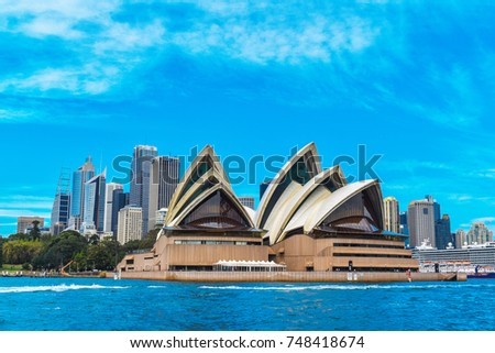 Sydney, Australia - 30th of October 2017. City scape skyline view of Sydney, Harbour bridge and the CBD from the ferry to Manly on a warm summer day with clear blue skies.  #748418674