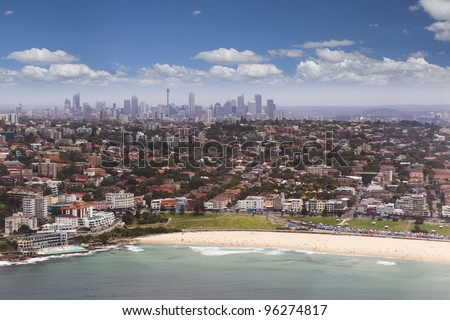 Sydney CBD and suburbs aerial view from Bondi beach and ocean to city centre with skyscrapers from Helicopter - stock photo