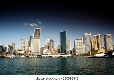 Stock Photo of Sydney CBD from Sydney Harbour featuring the city, circular quays, the rocks, ferry and waterfront skyline. Modern and heavily polarised.