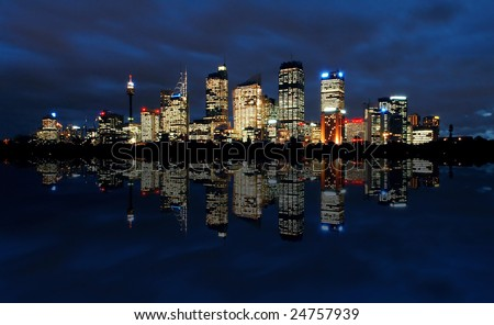 sydney cbd panorama at night, buildings reflection in water, dark cloudy night sky