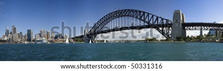 Sydney city AUstralia panorama harbour bridge circular quay liner ferries yachts - stock photo