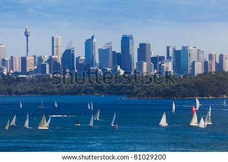 Sydney city CBD cityscape day view from milsons point across harbour with bridge blue water and sky north head