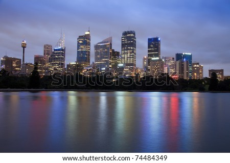 sydney city CBD skyscrapers cityscape at dusk twilight time illuminated office buildings water reflection