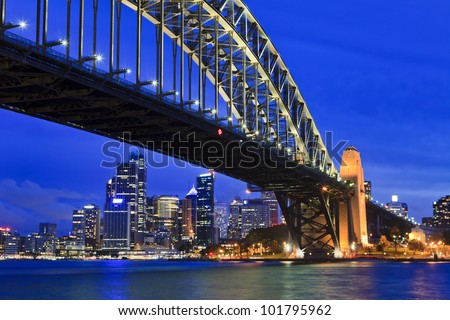 Sydney city cbd sunset close up view with lights and illumination view from under the bridge