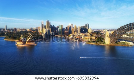 Sydney city landmarks around harbour waters - Harbour bridge, CBD, Circular Quay and the Rocks viewed from above. #695832994