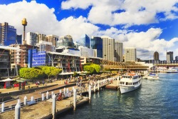 Sydney Darling Harbour Kings wharf with docked ship along the pier with modern architecture towers and skyscrapers on a sunny summer day.