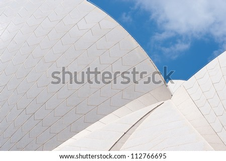 SYDNEY - FEBRUARY 8: The Iconic Sails of the Sydney Opera House are made up of over one million white, self cleaning tiles. February 8, 2012 in Sydney, Australia. - stock photo