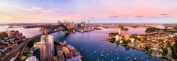 Sydney harbour and major city landmakrs around Lavender bay in aerial panorama at sunrise.