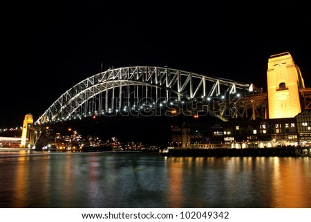 Sydney Harbour Bridge at night viewed from Walsh Bay
