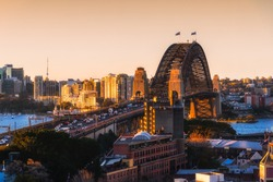 Sydney harbour bridge, Landscape view of Sydney city skyline with Sydney harbour bridge north shore in sunset sky, Australia.