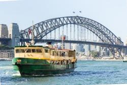 Sydney Harbour City Ferry in Circular Quay with Sydney Harbour Bridge background