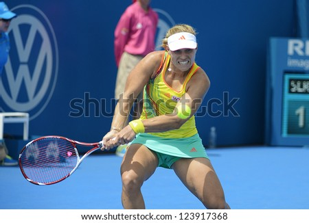 SYDNEY - JAN 8: Angelique Kerber from the Germany hitting a backhand in her first round match in the APIA Sydney Tennis International. Sydney January 8, 2013.