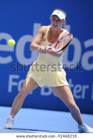 SYDNEY - JAN 10: Caroline Wozniacki hits a backhand in her opening round match in the APIA Tennis International. Sydney - January 10, 2012