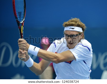 SYDNEY - JAN 9: Denis Istomin from Uzbekistan hits a backhand in his second round match in the APIA Sydney Tennis International. Sydney January 9, 2013.