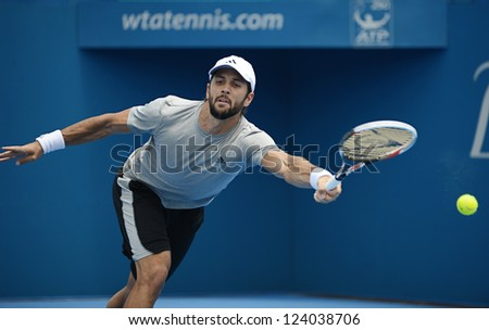 SYDNEY - JAN 9: Fernando Verdasco reaches to return serve during his second round match in the APIA Sydney Tennis International. Sydney January 9, 2013.