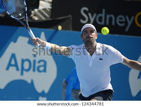 SYDNEY - JAN 11: Julien Benneteau from France hits a forehand in the semi finals of the APIA Sydney Tennis International. Sydney January 11, 2013.