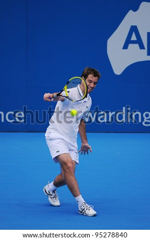 SYDNEY - JAN 12: Richard Gasquet from France plays a backhand in his match in the APIA Tennis International. Sydney - January 12, 2012