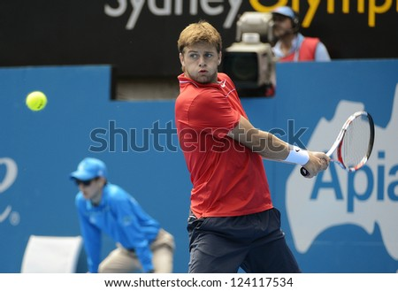 SYDNEY - JAN 9: Ryan Harrison from the USA hits a backhand in his second round match in the APIA Sydney Tennis International. Sydney January 9, 2013.
