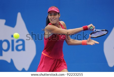 SYDNEY - JAN 8: Serbian Ana Ivanovic hits a forehand during her first round match in the APIA Tennis International. Sydney - January 8, 2012