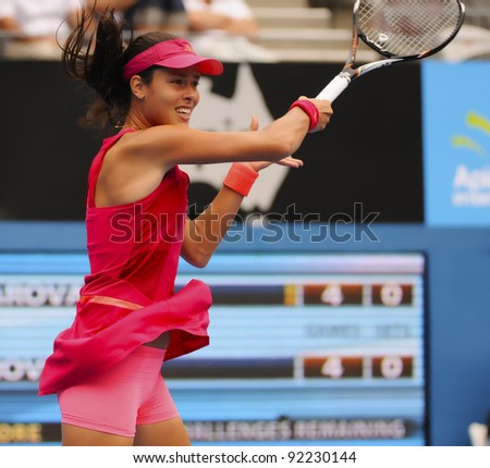 SYDNEY - JAN 8: Serbian Ana Ivanovic returns a serve during her first round match in the APIA Tennis International. Sydney - January 8, 2012