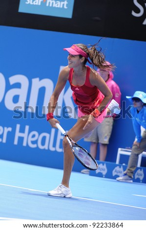 SYDNEY - JAN 8: Serbian Ana Ivanovic serves during her first round match in the APIA Tennis International. Sydney - January 8, 2012