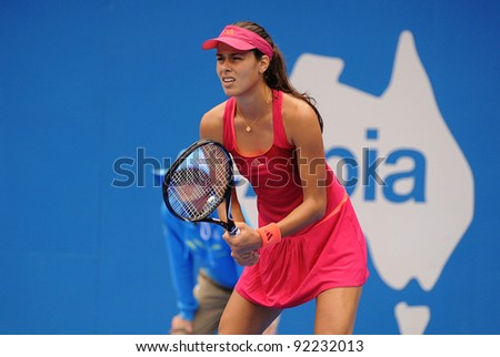 SYDNEY - JAN 8: Serbian Ana Ivanovic waits for a serve during her first round match in the APIA Tennis International. Sydney - January 8, 2012