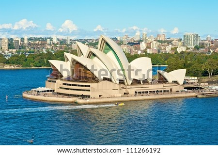 SYDNEY - JULY 8: Sydney Opera House view on July 8, 2012 in Sydney, Australia. The Sydney Opera House is a famous arts center. It was designed by Danish architect Jorn Utzon, finally opening in 1973.