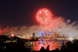 Sydney new year fireworks big red ball of pyrotechnics fire flashes above city, harbour and bridge