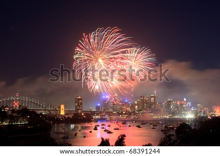 Sydney new year fireworks over CBD Harbour bridge color flash ball