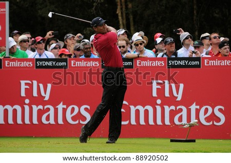 SYDNEY - NOV 13: American golfer Tiger Woods plays a iron from the 16th tee in his fourth round at the Emirates Australian Open at The Lakes golf course on November 13, 2011 in Sydney, Australia. - stock photo