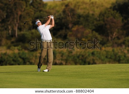 SYDNEY - NOV 11: - John Cook watches his ball fly high and straight at the Emirates Australian Open at The Lakes golf course. Sydney - November 11, 2011