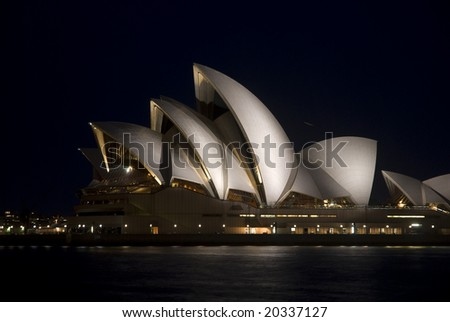SYDNEY, November 11, 2008 - Night horizontal side view of floodlit Sydney Opera House with harbour in foreground. Photographed in Sydney, Australia on 11 November, 2008.