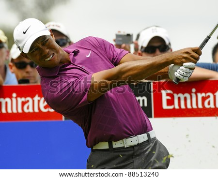 SYDNEY - NOVEMBER 10: Tiger Woods plays a tee shot in the first round in the Australian Open at The Lakes golf course on November 10, 2011 in Sydney, Australia.