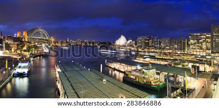 Sydney, NSW, AUstralia - April 7, 2012: City\'s iconic place with famous Opera House, Harbour Bridge and Circular QUay at sunset