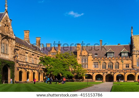 Sydney Uni inner yard with students in the distance enjoying break. University of Sydney courtyard against deep blue sky with white clouds, daytime photo