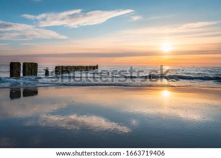 Sylt island sunset over North Sea water. Sylt island beach at sunset. North Sea beach twilight landscape. Horizon over sea. Photo stock ©