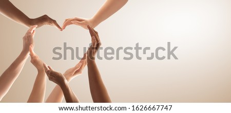 Photo of  Symbol and shape of heart created from hands.The concept of unity, cooperation, partnership, teamwork and charity.