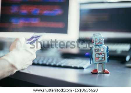 Symbol for a chatbot or social bot and algorithms, program code in the background