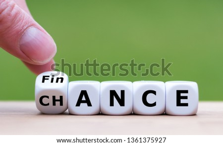 "Symbol for a good finance chance. Hand turns a dice and changes the word ""FINANCE"" to ""CHANCE"". #1361375927"