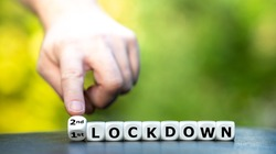 Symbol for a second lockdown. Hand turns dice and changes the expression