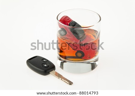 symbol for drunken driving. a car and a carkey in a glass