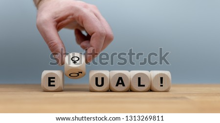 "Symbol for gender equality.. Dice form the word ""EQUAL"" in front of a grey background. Instead of the letter Q the symbols for women and men are used.  #1313269811"