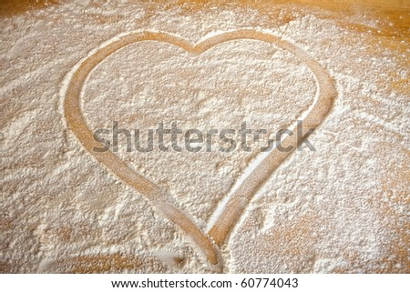 Symbol heart painted in flour on baking