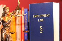 Symbol image: Reference book employment law and a Justitia