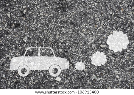 Symbol of a polluting car painted on the surface of an asphalt road.