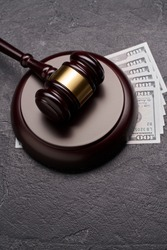 Symbol of court and justice, gavel, dollars