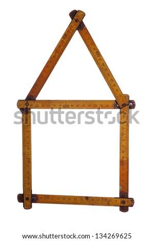 symbol of house made of old yardstick #134269625