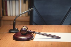 Symbol of judge and justice. Fair and legitimate decision. Judge's gavel  wooden table. Concept of law. Court, lawmakers and law. Bidding at auction.